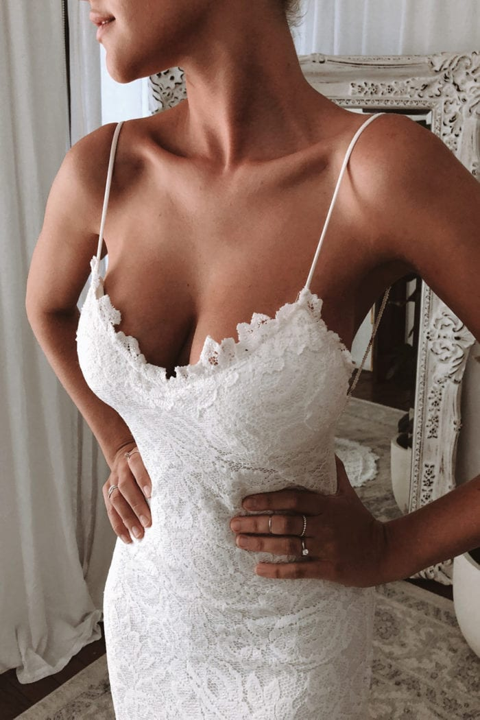 Close-up shot of bride wearing Grace Loves Lace Hart Gown with hands on hips
