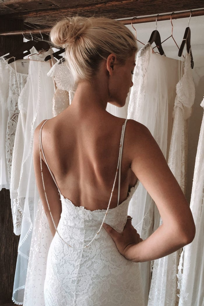 Back shot of bride wearing Grace Loves Lace Hart Gown with backpiece