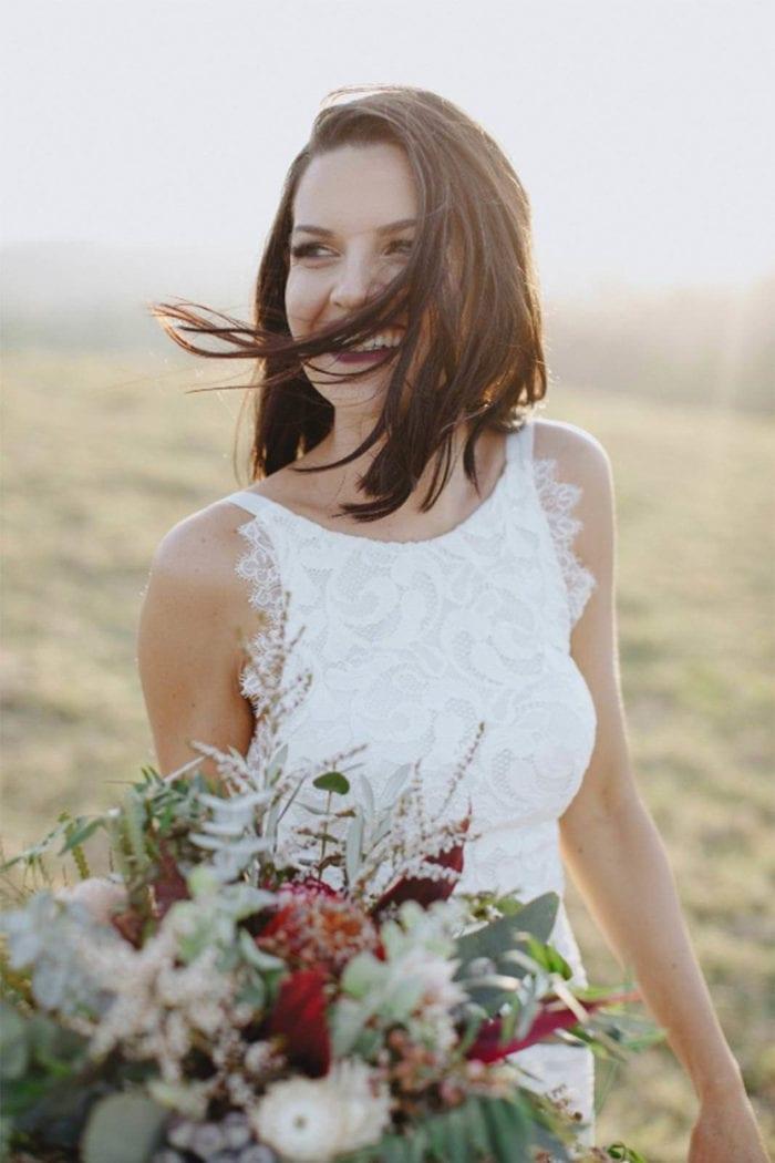 Brunette bride wearing Grace Loves Lace Nia 2.0 Gown holding bouquet