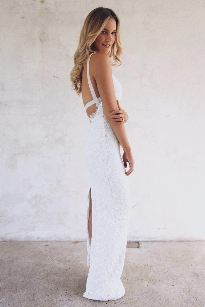 Blonde bride wearing Grace Loves Lace Nia 2.0 Gown looking over shoulder