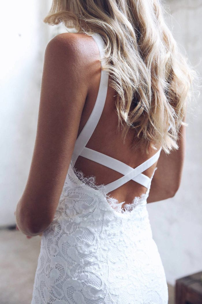 Back shot of bride wearing Grace Loves Lace Nia 2.0 Gown
