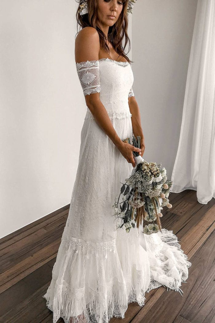 Brunette bride wearing Grace Loves Lace Fabienne 2.0 Gown holding bouquet