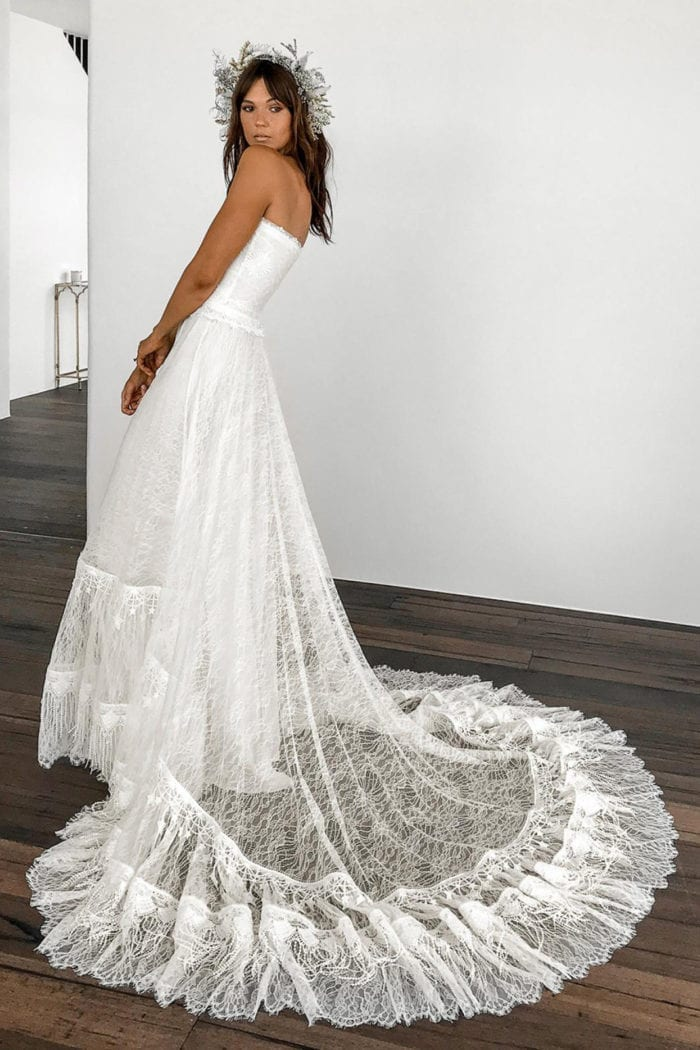 Brunette bride wearing Grace Loves Lace Fabienne 2.0 Gown looking over shoulder