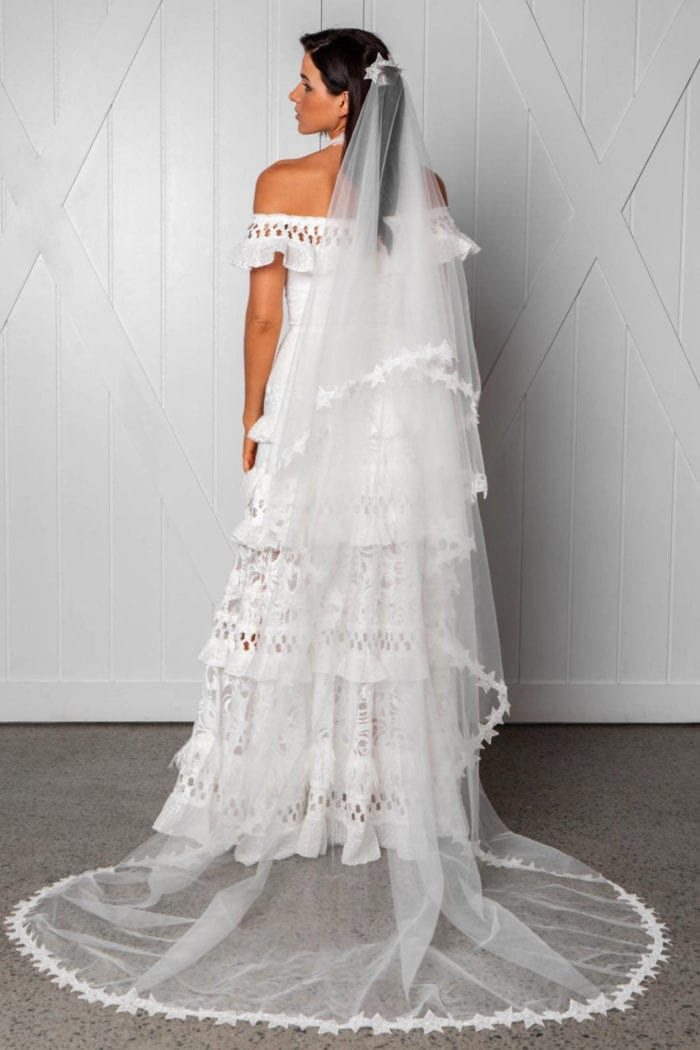 Back shot of bride wearing Grace Loves Lace Elson Veil looking to the side