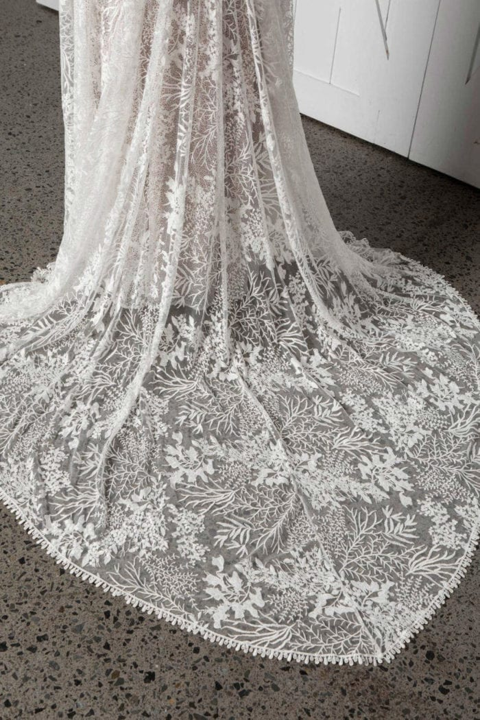 Close-up shot of Bride wearing Grace Loves Lace Sol Gown showing skirt