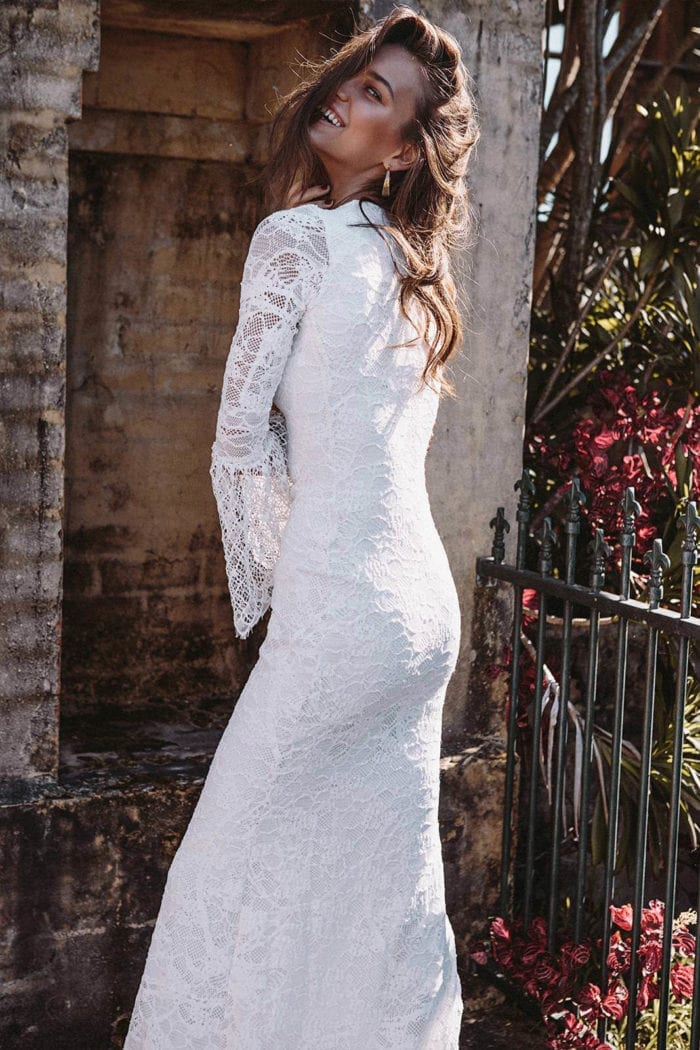 Back shot of brunette bride wearing Grace Loves Lace Piper Gown