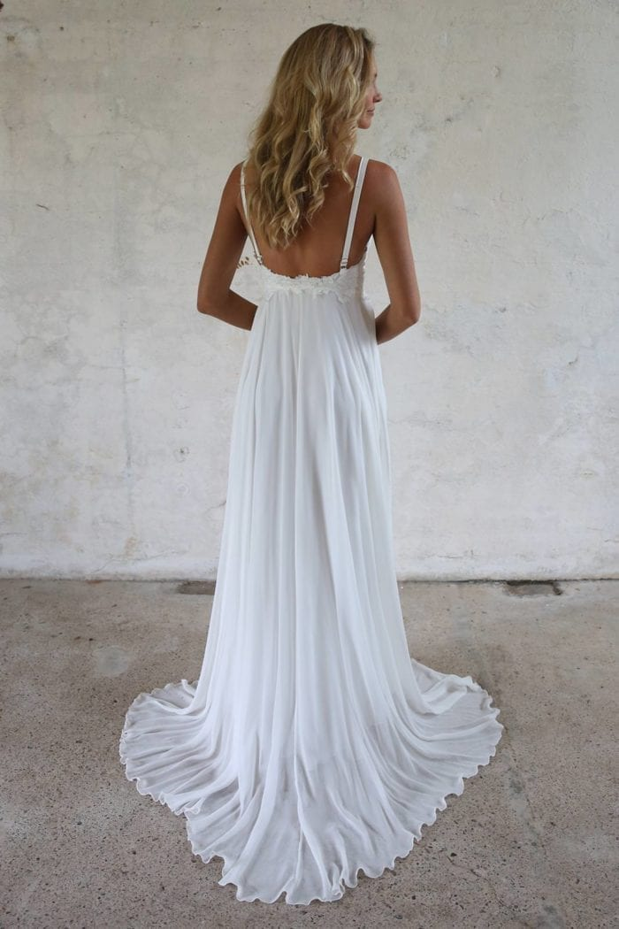 Back shot of blonde bride wearing Grace Loves Lace Tara Gown looking to the side