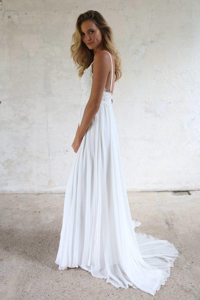 Side shot of blonde bride wearing Grace Loves Lace Tara Gown