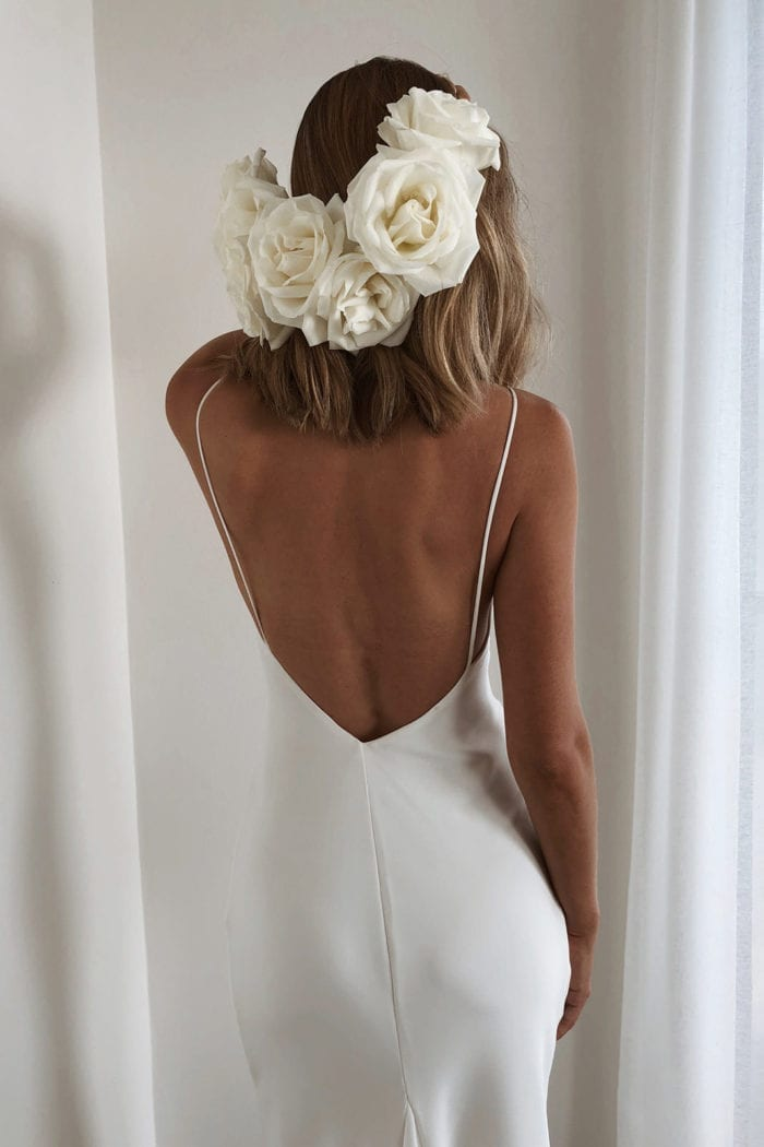 Back shot of bride wearing Grace Loves Lace Summer Gown wearing flower crown