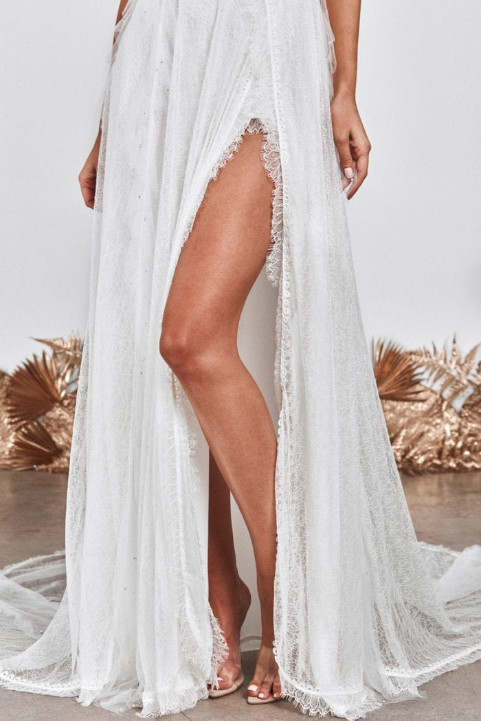 Close-up of Grace Loves Lace Song Gown skirt and trim