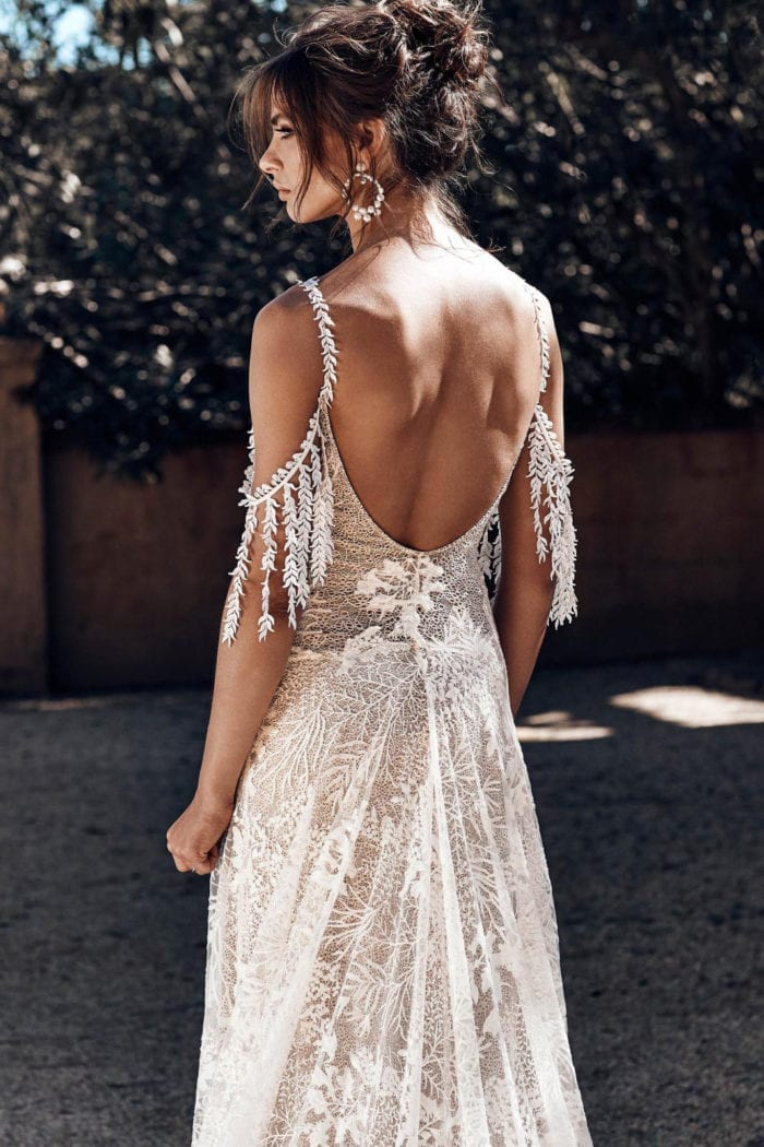 Back shot of bride wearing Grace Loves Lace Sol Gown