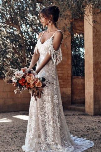 Bride wearing Grace Loves Lace Sol Gown holding bouquet