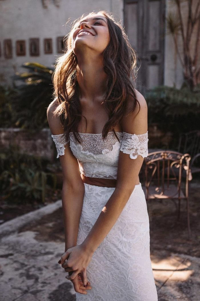 Brunette bride wearing Grace Loves Lace Saffi Gown laughing
