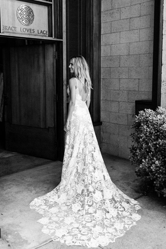 Black and white back shot of bride wearing Grace Loves Lace Rosa Gown
