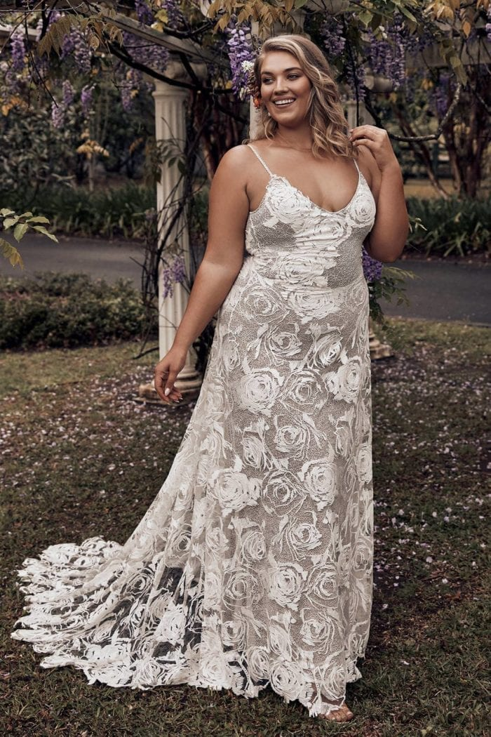 Bride wearing Grace Loves Lace Rosa Gown with hand on hair