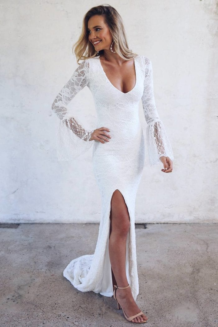 Blonde bride wearing Grace Loves Lace Piper Gown with hand on hip