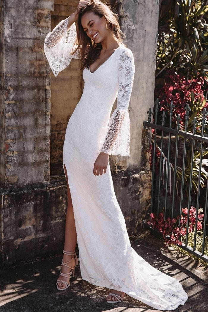 Brunette bride wearing Grace Loves Lace Piper Gown with hand on hair