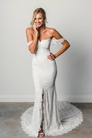 Blonde bride wearing Grace Loves Lace Paloma Gown with hand on hip