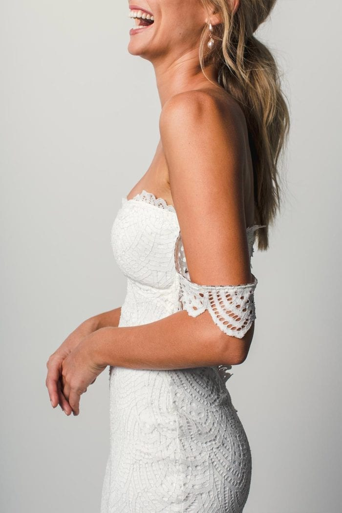 Close-up of bride wearing Grace Loves Lace Paloma Gown