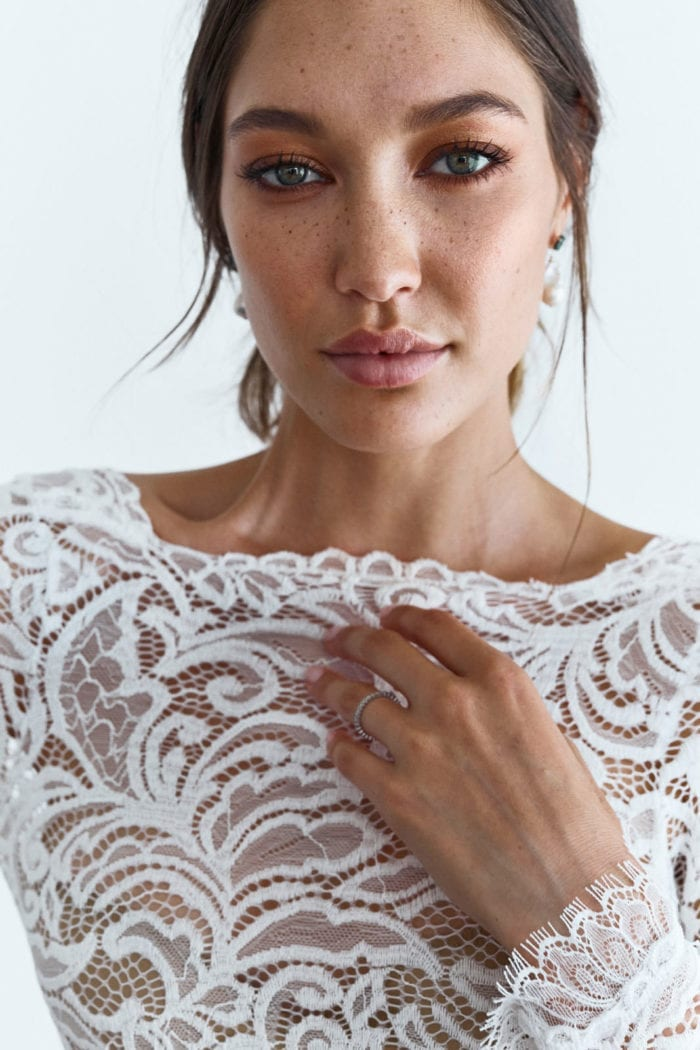 Close-up shot of bride wearing Grace Loves Lace Orla Gown