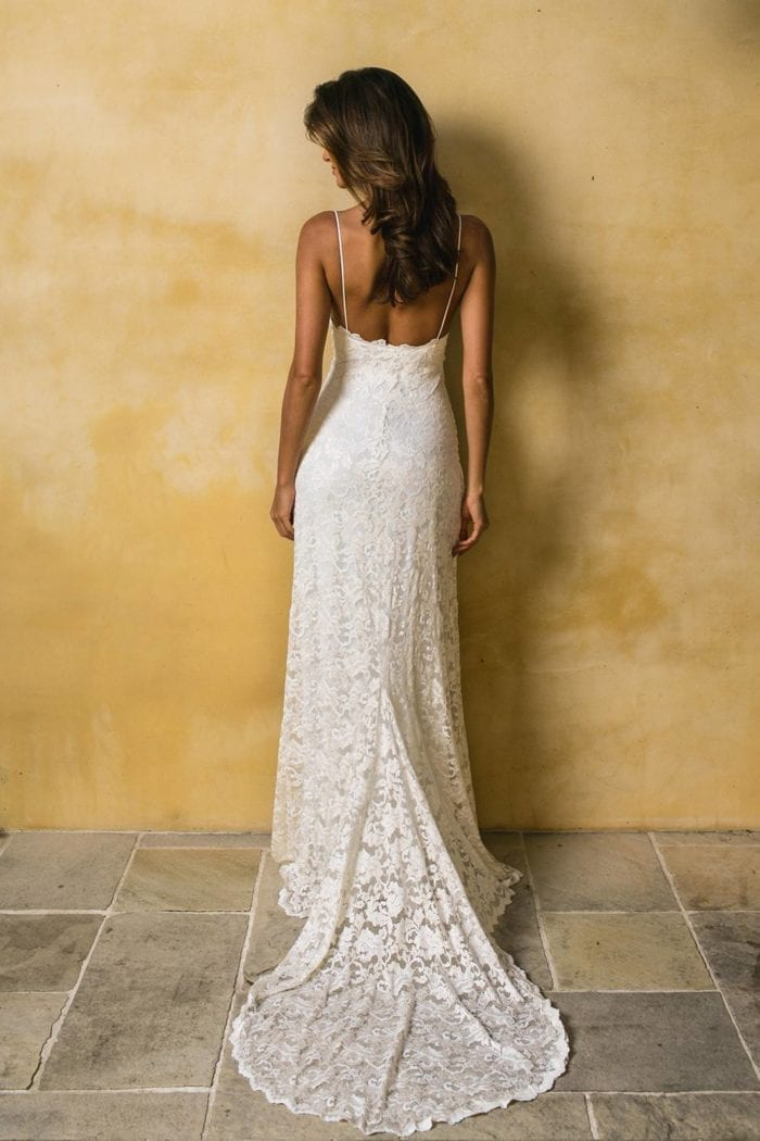 Back shot of bride wearing Grace Loves Lace Mia Gown looking to the side