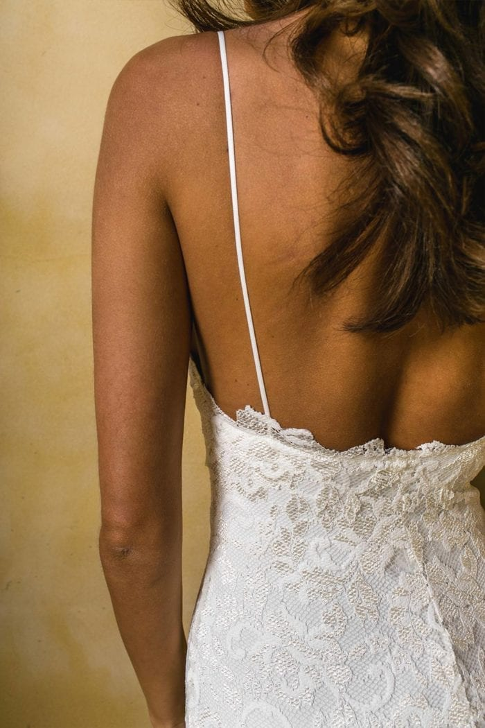 Back shot of bride wearing Grace Loves Lace Mia Gown