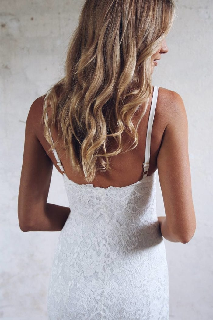 Back shot of blonde bride wearing Grace Loves Lace Mia Gown