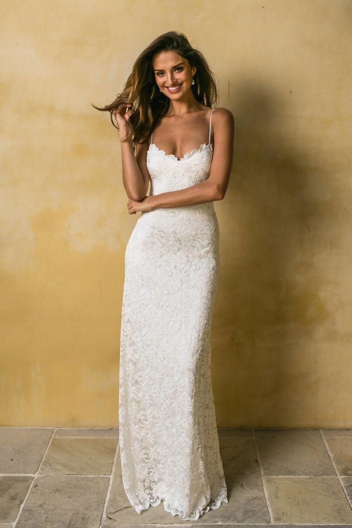 Brunette bride wearing Grace Loves Lace Mia Gown with hand on hair