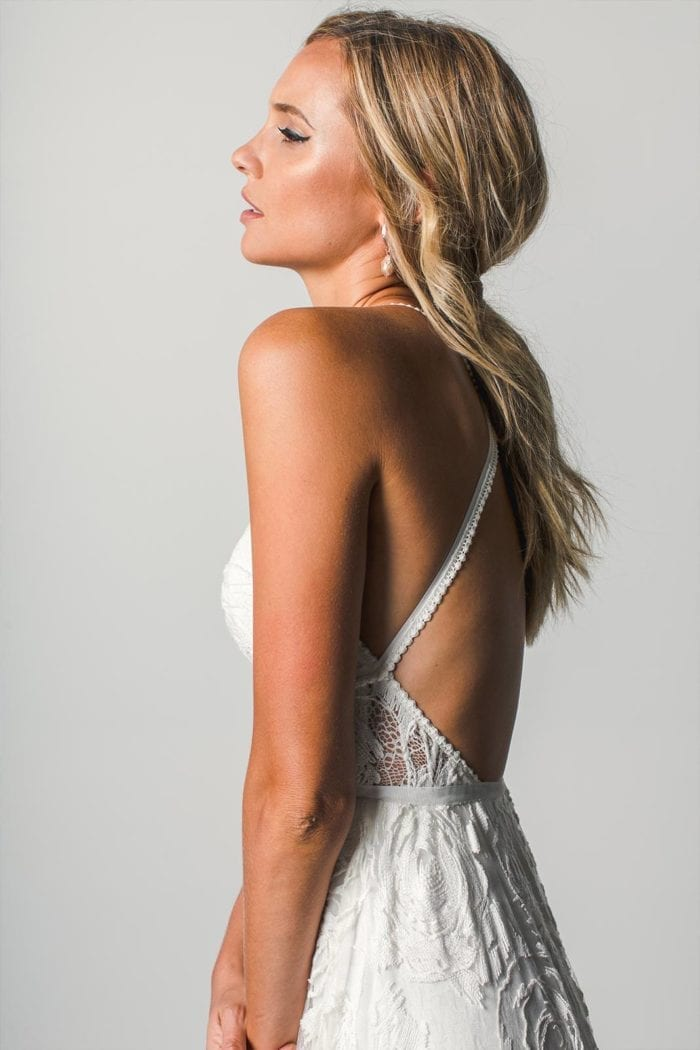Side shot of blonde bride wearing Grace Loves Lace Megan Gown