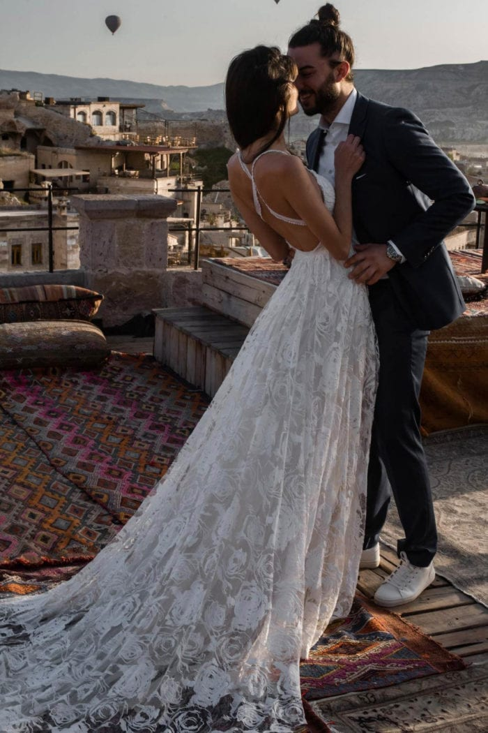Brunette bride wearing Grace Loves Lace Megan Gown embracing groom
