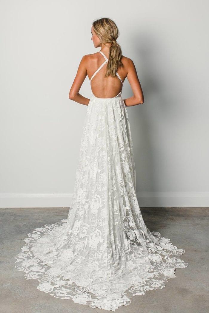 Back shot of blonde bride wearing Grace Loves Lace Megan Gown
