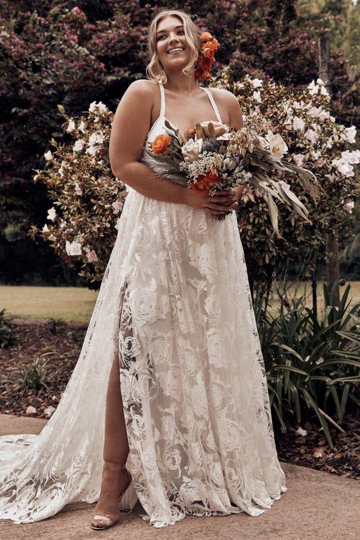 Blonde bride wearing Grace Loves Lace Megan Gown holding bouquet