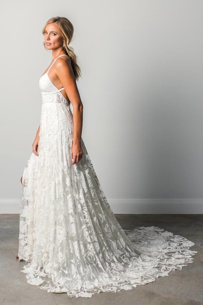 Blonde bride wearing Grace Loves Lace Megan Gown looking over shoulder