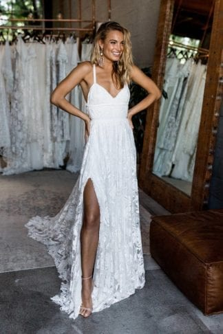 Blonde bride wearing Grace Loves Lace Megan Gown with hands on hips