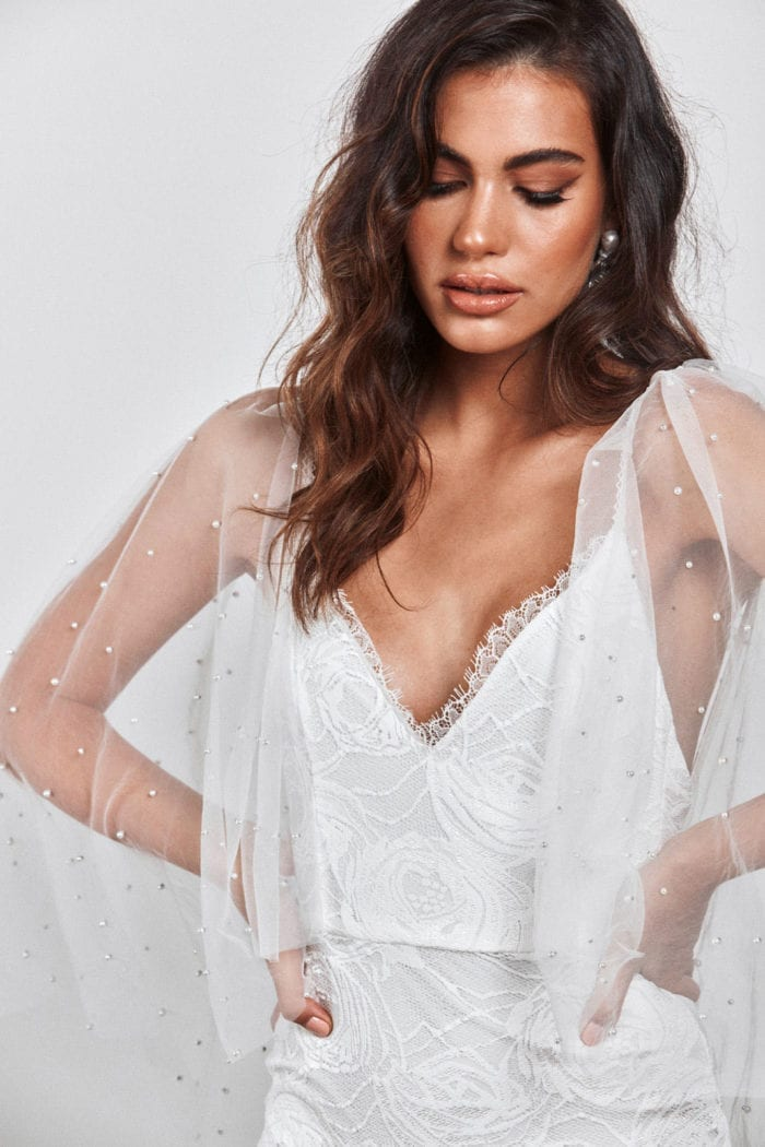 Brunette bride wearing Grace Loves Lace Matti Gown with hands on hips