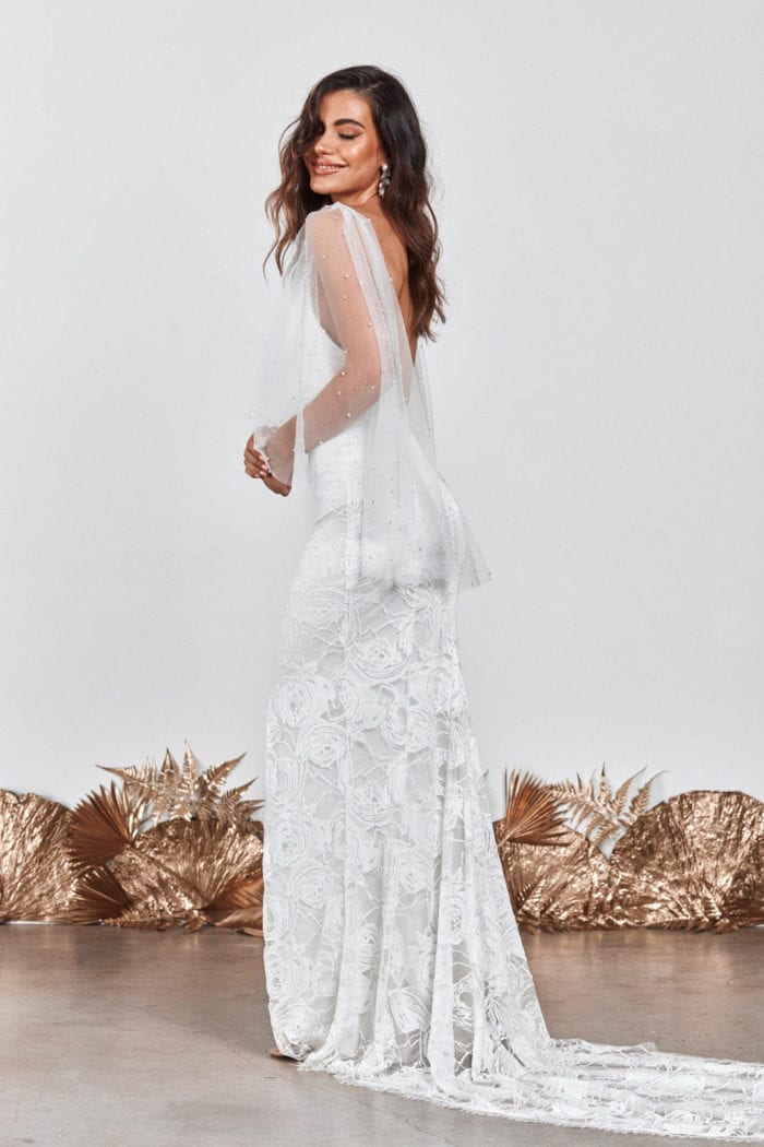 Side shot of brunette bride wearing Grace Loves Lace Matti Gown