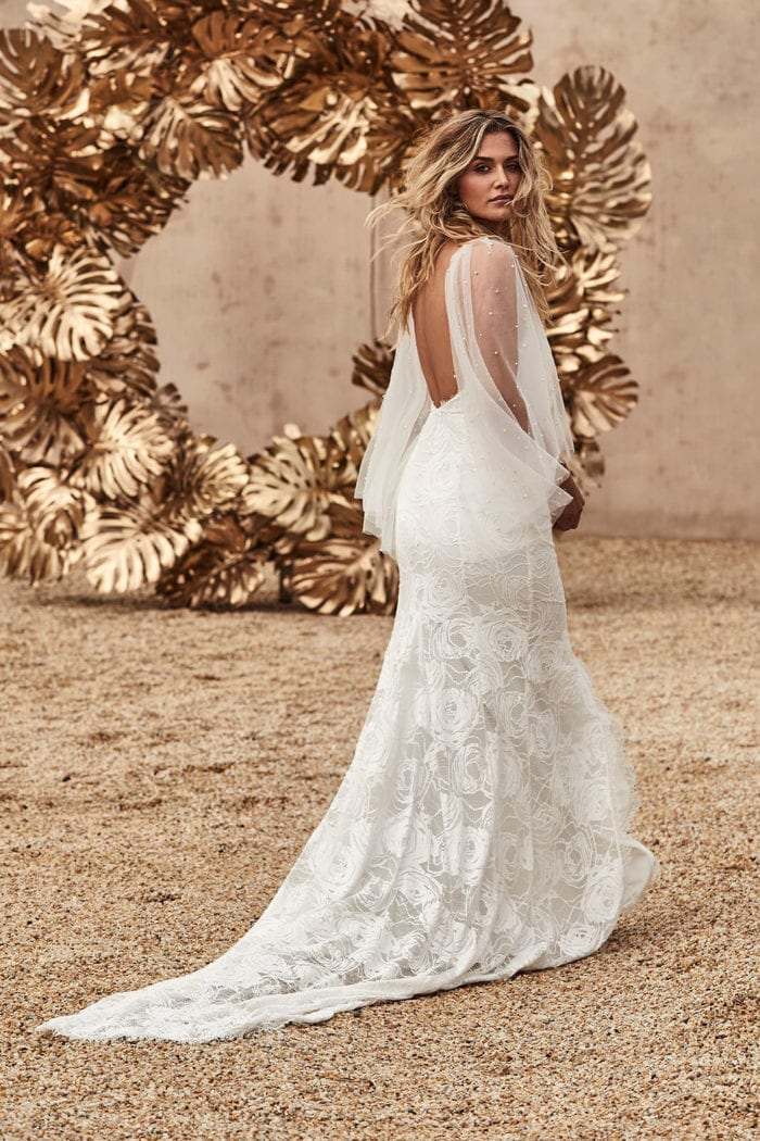 Blonde bride wearing Grace Loves Lace Matti Gown looking over shoulder