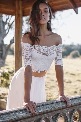 Brunette bride wearing Grace Loves Lace Luna Gown leaning on handrail