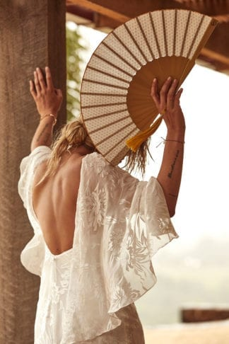 Back shot of blonde ride wearing Grace Loves Lace Loyola Gown With Sleeves holding fan