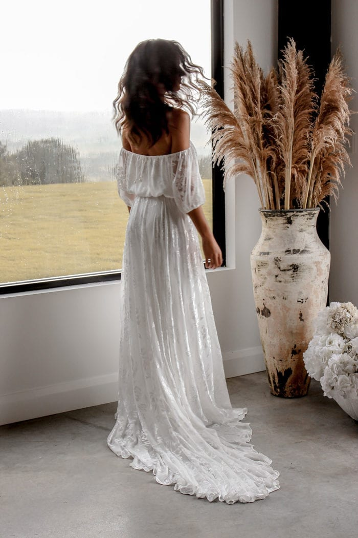 Back shot of bride wearing Grace Loves Lace Loyola Set in front of window