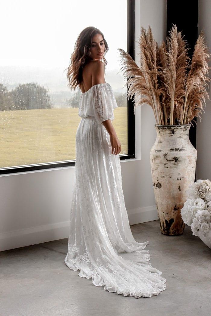 Brunette bride wearing Grace Loves Lace Loyola Set in front of window