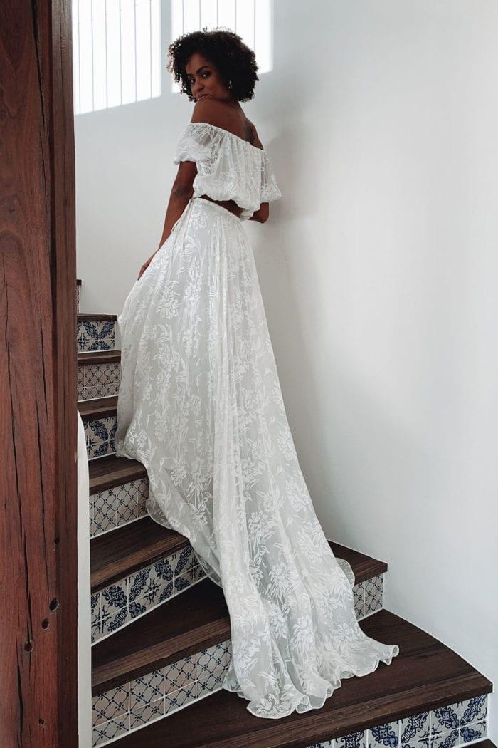 Back shot of brunette bride wearing Grace Loves Lace Loyola Set walking up stairs