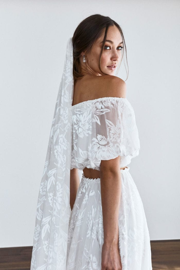 Brunette bride wearing Grace Loves Lace Loyola Set and matching veil