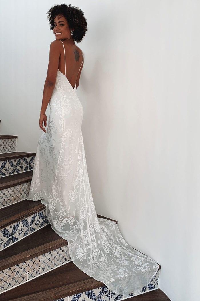 Brunette bride wearing Grace Loves Lace Loyola Gown walking up stairs