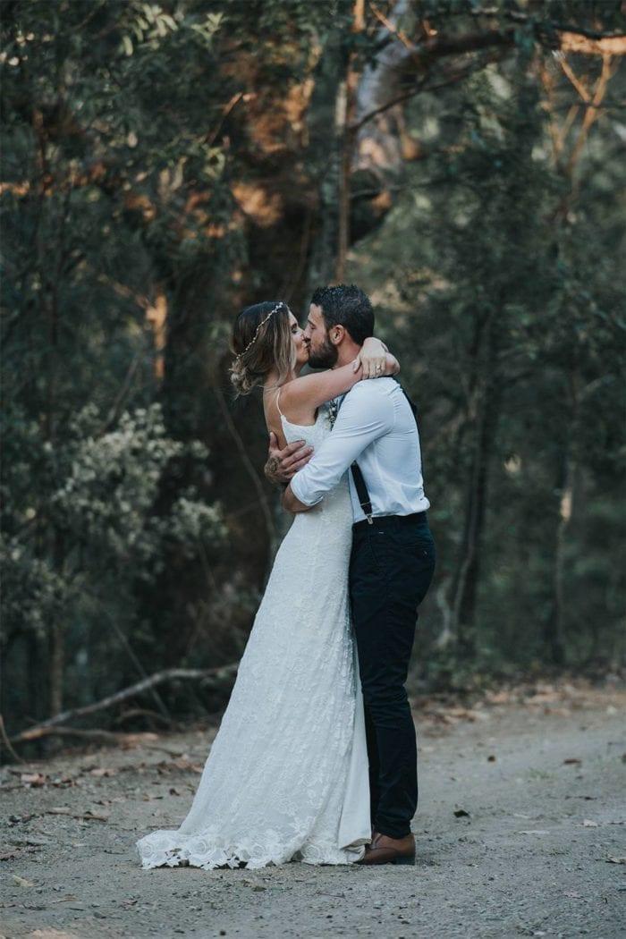 Brunette bride wearing Grace Loves Lace Lottie Gown kissing groom