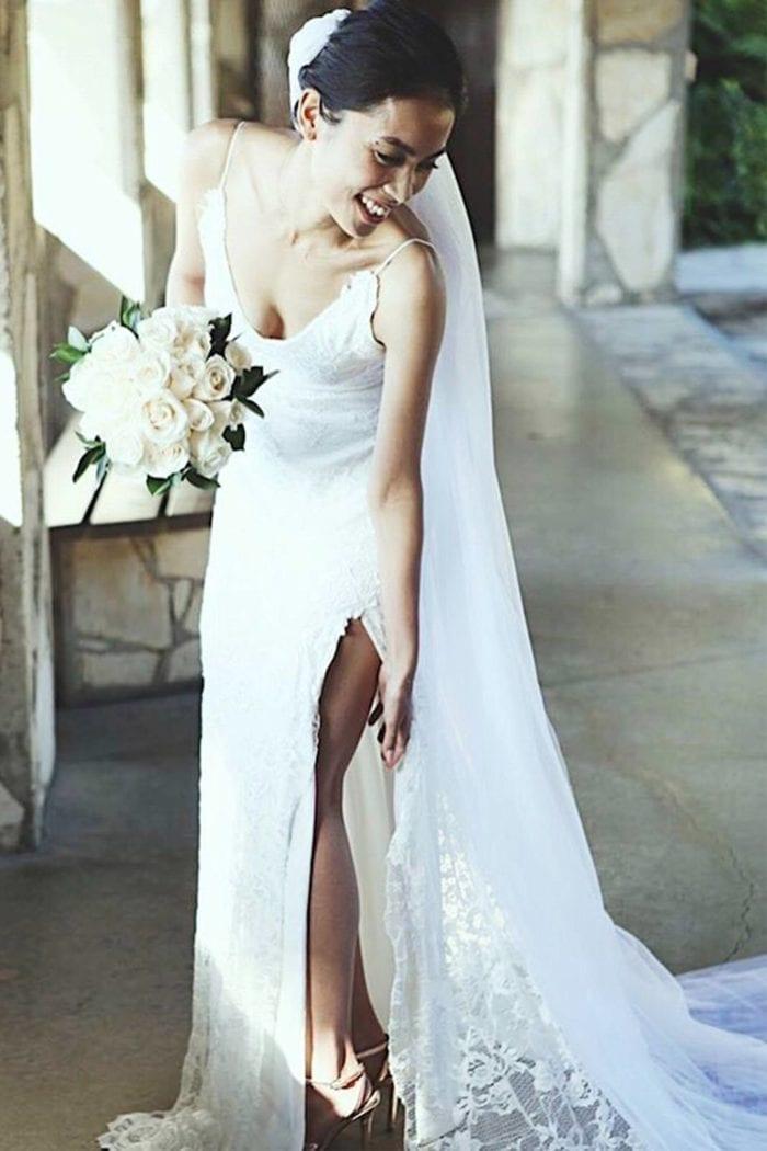 Brunette bride wearing Grace Loves Lace Lottie Gown holding bouquet