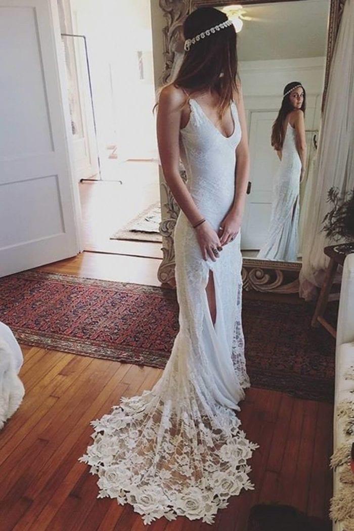 Brunette bride wearing Grace Loves Lace Lottie Gown looking in mirror