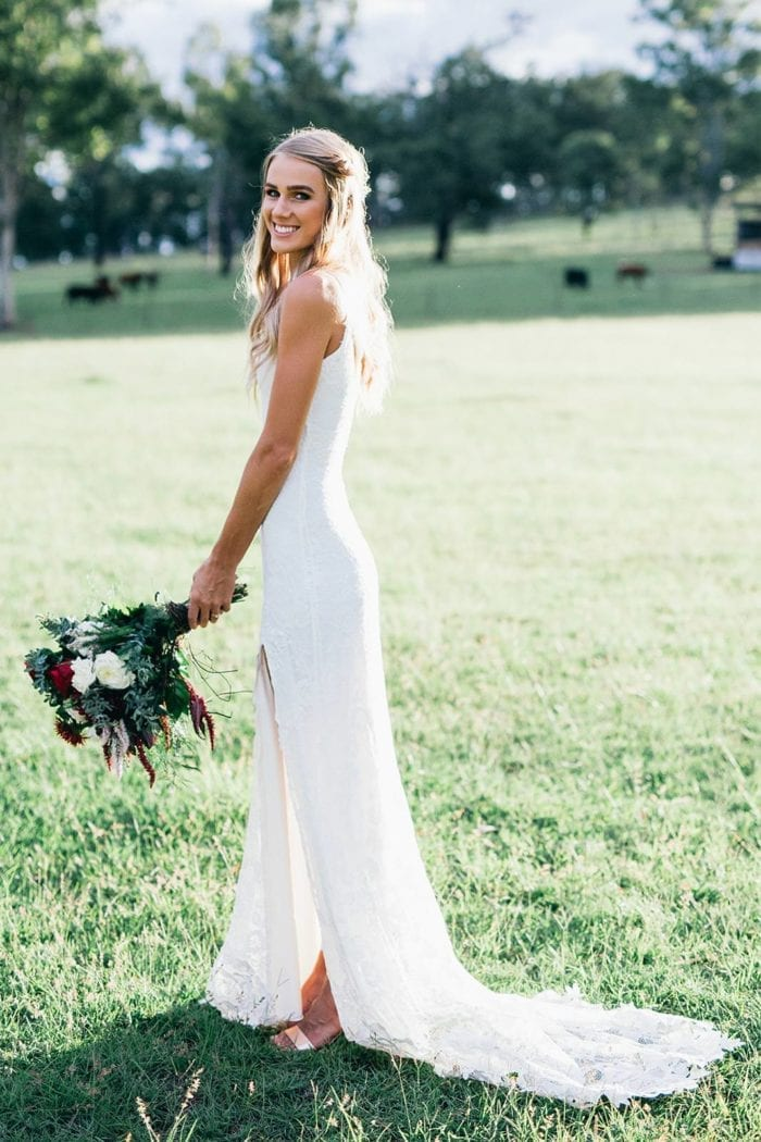 Blonde bride wearing Grace Loves Lace Lottie Gown holding bouquet