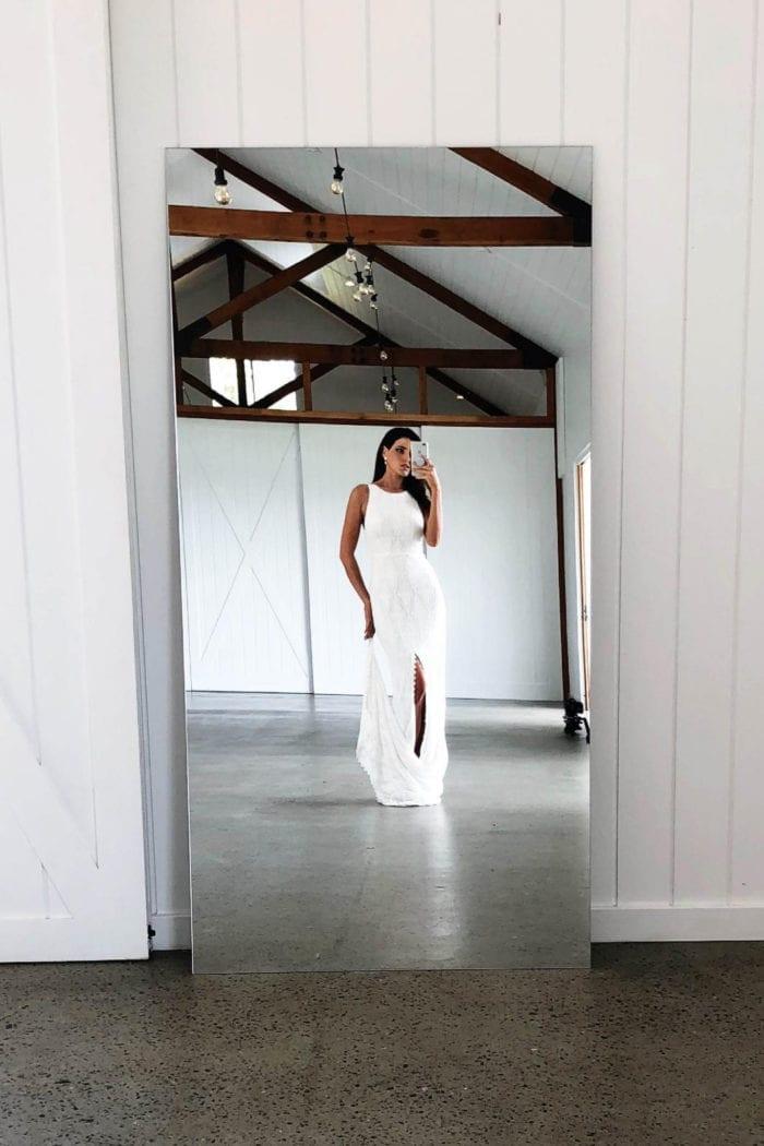 Brunette bride wearing Grace Loves Lace Leon Gown taking photo in mirror