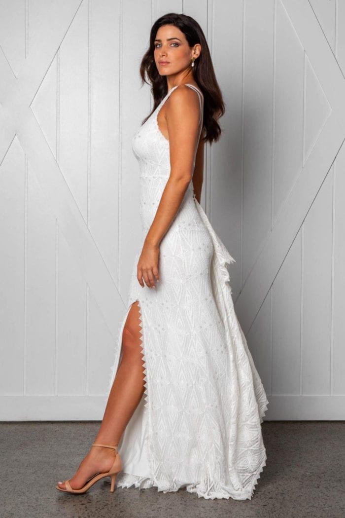 Side shot of brunette bride wearing Grace Loves Lace Leon Gown